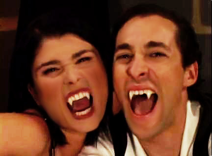 Dracula Fangs on Man and Woman